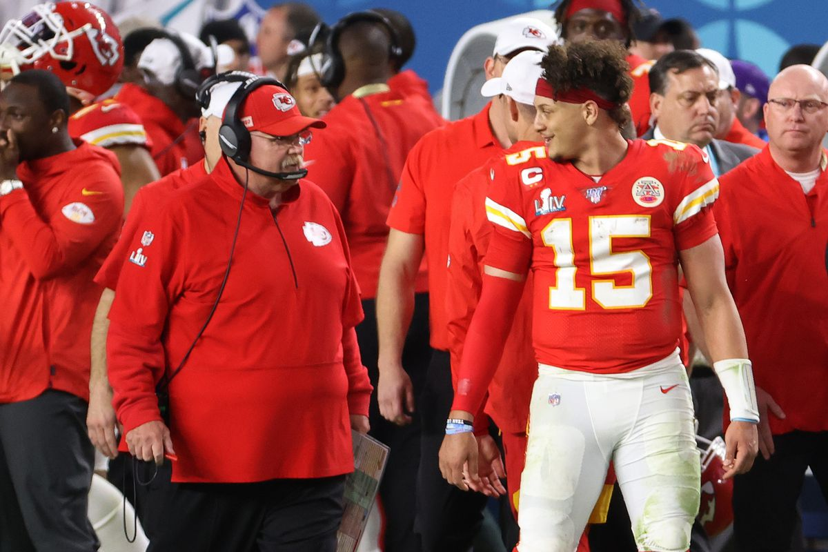 Kansas City Chiefs quarterback Patrick Mahomes smiles at Chiefs head coach Andy Reid on the sidelines after throwing a touchdown pass against the San Francisco 49ers in the fourth quarter in Super Bowl LIV at Hard Rock Stadium.