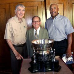 Arnie Ferrin, Grant Harrison and Ron Boone pose for a photo with the the Utah Stars\' 1971 ABA Championship trophy at the Alta Club in Salt Lake City on Thursday, July 18, 2013.