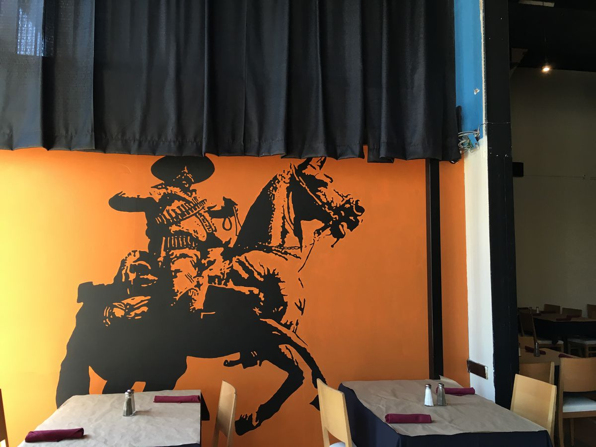 A mural at Norte Modern Mexican by artist Walsh Gil.