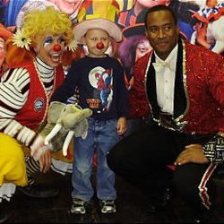 Chase Redd, 5, center, was selected as Utah's Funniest Kid during a competition at the Utah State Fair featuring Daisy, the clown, left, and Ringling Bros. and Barnum and Bailey Circus ringmaster Tyron McFarlan.