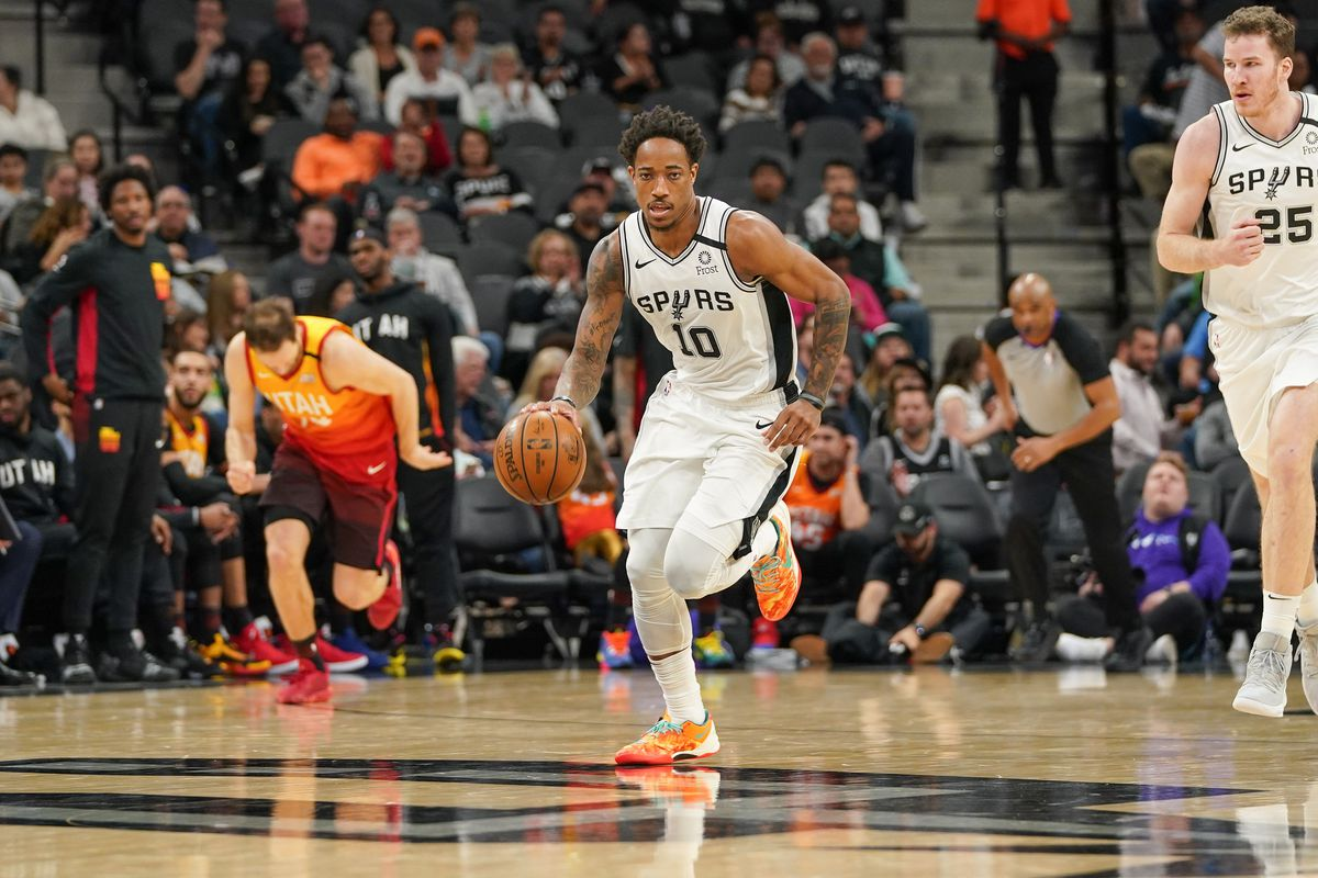 San Antonio Spurs forward DeMar DeRozan brings the ball up the court in the second half against the Utah Jazz at the AT&T Center.