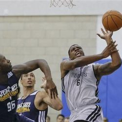 Houston Rockets' Terrence Jones (6) looses control of the ball as he is guarded by Utah Jazz's Rick Jackson (96) during an NBA summer league basketball game, Tuesday, July 9, 2013, in Orlando, Fla. (AP Photo/John Raoux)
