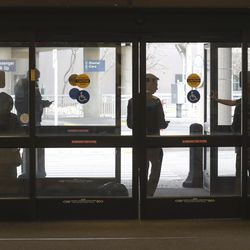 Airline crews wait between the exit doors at the Salt Lake City International Airport after a 5.7 magnitude earthquake centered in Magna caused the airport to be evacuated and closed on Wednesday, March 18, 2020.