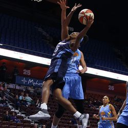 Atlanta Dream's Tiffany Hayes (15) drives to the basket against Chicago Sky's Elena Delle Donne (11).