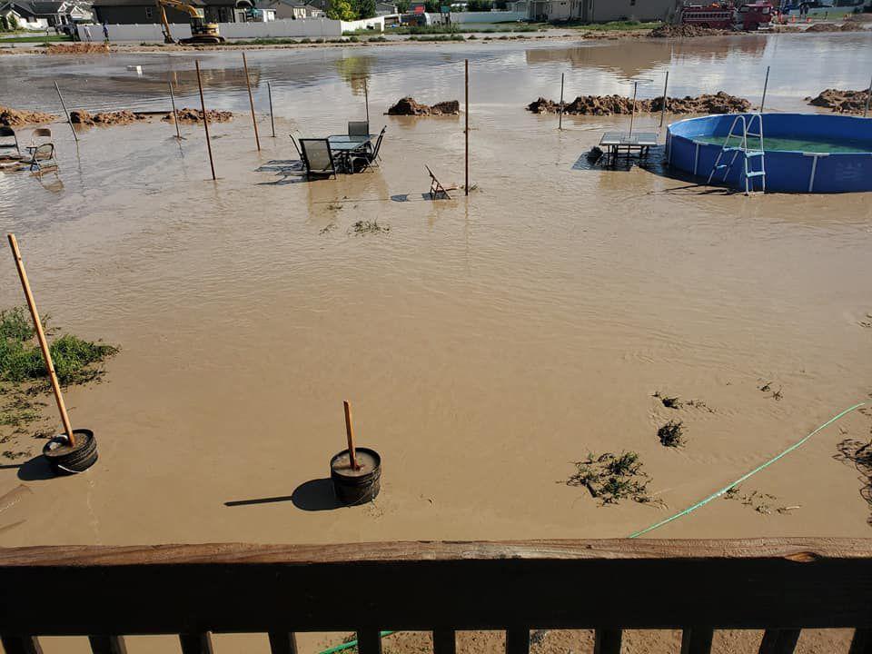 Flash floods fill a yard in Enoch on Aug. 1, 2021.