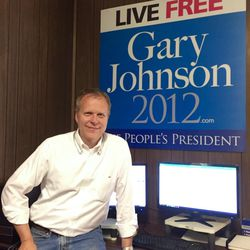 Utahn Ron Nielson poses with a 2012 campaign poster for Libertarian Party candidate Gary Johnson. Nielson is managing Johnson's campaign again in 2016.