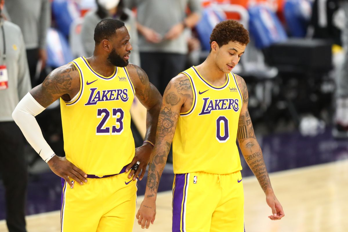Los Angeles Lakers forward LeBron James and Kyle Kuzma against the Phoenix Suns during a preseason game at Phoenix Suns Arena.