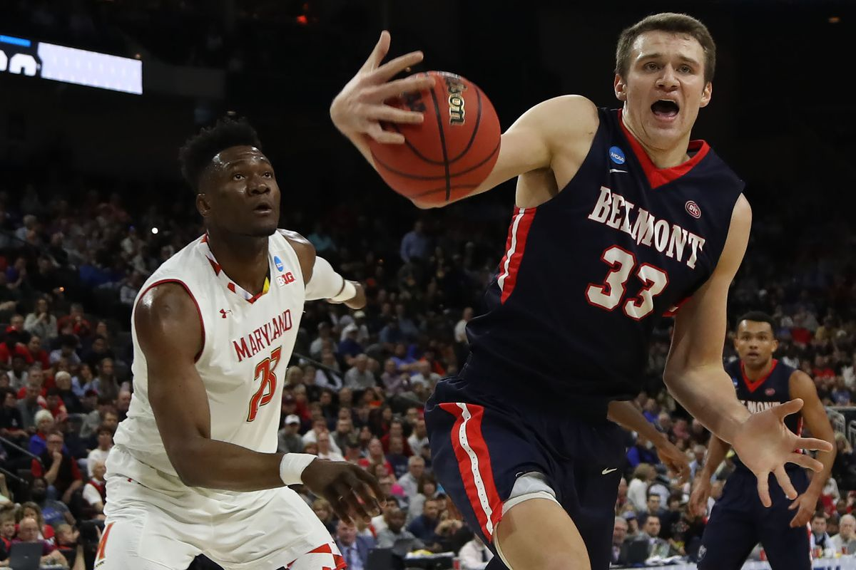 Nick Muszynski of the Belmont Bruins controls the ball against Bruno Fernando #23 of the Maryland Terrapins in the first half during the first round of the 2019 NCAA Men's Basketball Tournament at VyStar Jacksonville Veterans Memorial Arena on March 21, 2019 in Jacksonville, Florida.