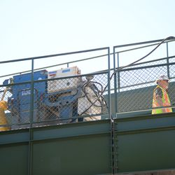 11:37 a.m. Work being done in the left-field bleachers -