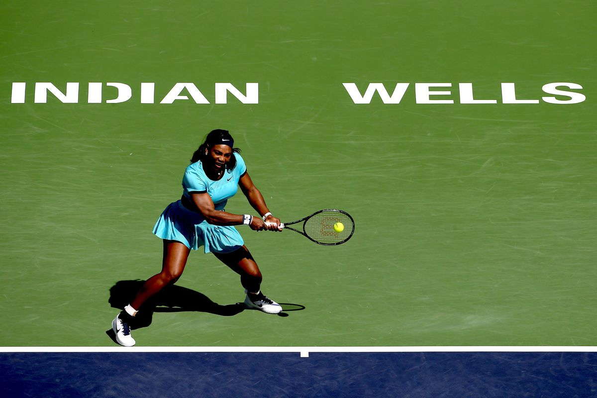 Serena Williams returns a shot to Victoria Azarenka of Belarus during the women's final of the BNP Paribas Open at the Indian Wells Tennis Garden on March 20, 2016 in Indian Wells, California.