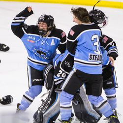 Buffalo Beauts Megan Bozek and Kelly Steadman celebrate with teammates seconds after their upset win over the Boston Pride in the 2017 Isobel Cup Finals