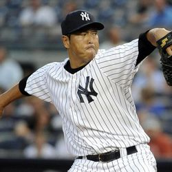 New York Yankees starting pitcher Hiroki Kuroda throws against the Baltimore Orioles in the first inning of a baseball game on Friday, Aug., 31, 2012, at Yankee Stadium in New York.