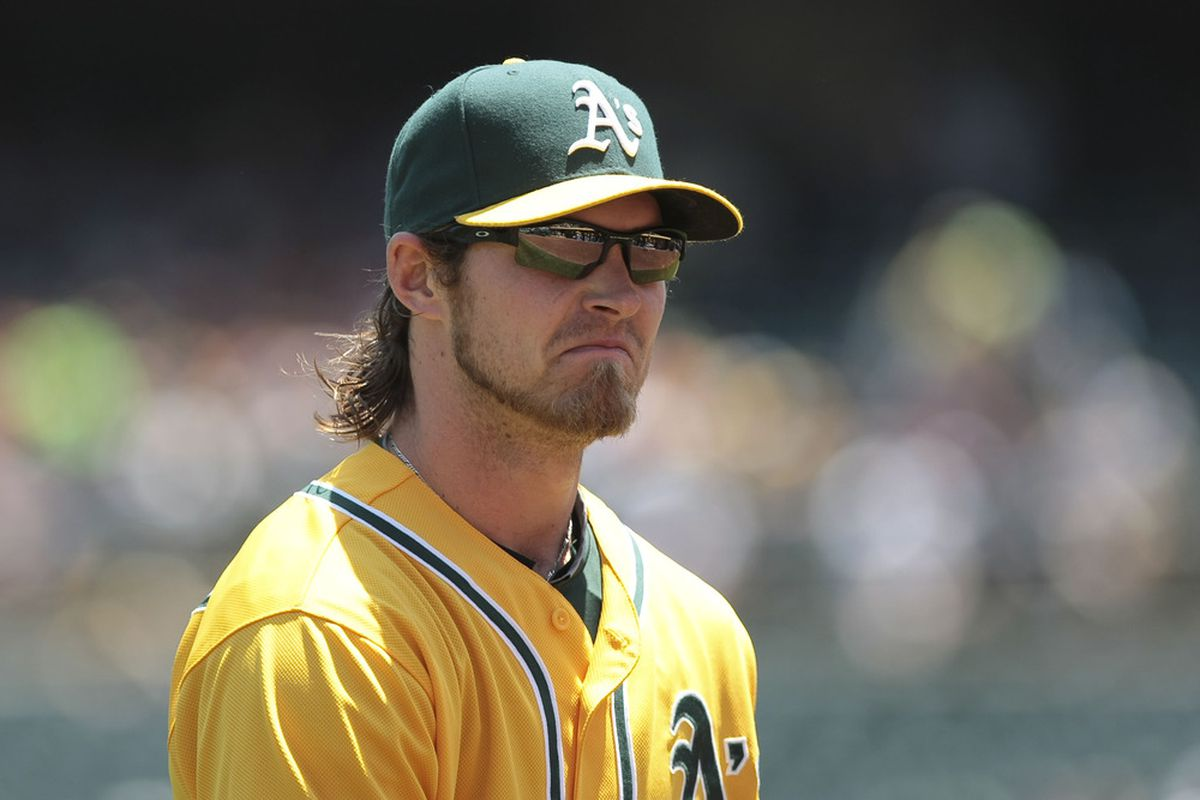 May 23, 2012; Oakland, CA, USA; Oakland Athletics right fielder Josh Reddick (16) returns to the dugout against the Los Angeles Angels during the second inning at O.co Coliseum. Mandatory Credit: Kelley L Cox-US PRESSWIRE