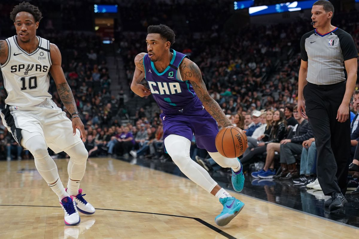 Charlotte Hornets guard Malik Monk drives past San Antonio Spurs forward DeMar DeRozan in the second half at the AT&T Center.