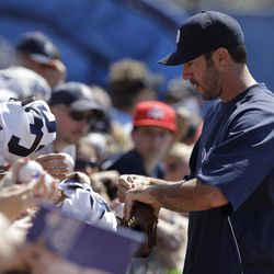 Detroit Tigers pitcher Justin Verlander signs autographs for fans before spring training baseball game against the Toronto Blue Jays in Dunedin, Fla., Tuesday, April 3, 2012.  Verlander is schedule to start on opening day against the Boston Red Sox, on Thursday, April 5, in Detroit.