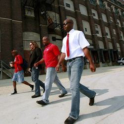 Chicago Teachers Union delegates arrive for a meeting Sunday, Sept. 16, 2012 in Chicago. Hundreds of CTU delegates are expected to review a proposed contract and vote on whether  to suspend the teachers strike which has kept more than 350,000 students out of school since Monday.