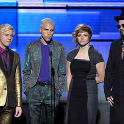 """Chris Allen, Tyler Glenn, Elaine Bradley and Branden Campbell, left to right, from the band Neon Trees present the award for favorite album - country at the 40th Anniversary American Music Awards on Sunday, Nov. 18, 2012, in Los Angeles. Bradley recently released her own """"I'm a Mormon"""" video."""