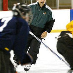 Grizzlies assistant coach Chuck Weber instructs players while running hockey drills during a clinic at the Cottonwood Heights Recreation Center.