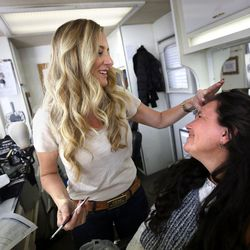 Becky Swasey makes Kymberly Mellen, who plays Sariah, look older with makeup techniques on the set of the Book of Mormon Visual Library at LDS Motion Picture Studios South Campus near Goshen on Friday, July 7, 2017.