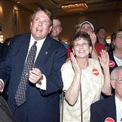 Rep. Merrill Cook celebrates with Republican supporters after winning re-election in Utah's 2nd Congressional District in November 1998.