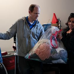 Stephen Gibbons, Luisa Rodriguez and other Check City employees deliver coats collected during the company's Warm Hearts Coat Drive to the men's resource center in South Salt Lake on Tuesday, Dec. 3, 2019.