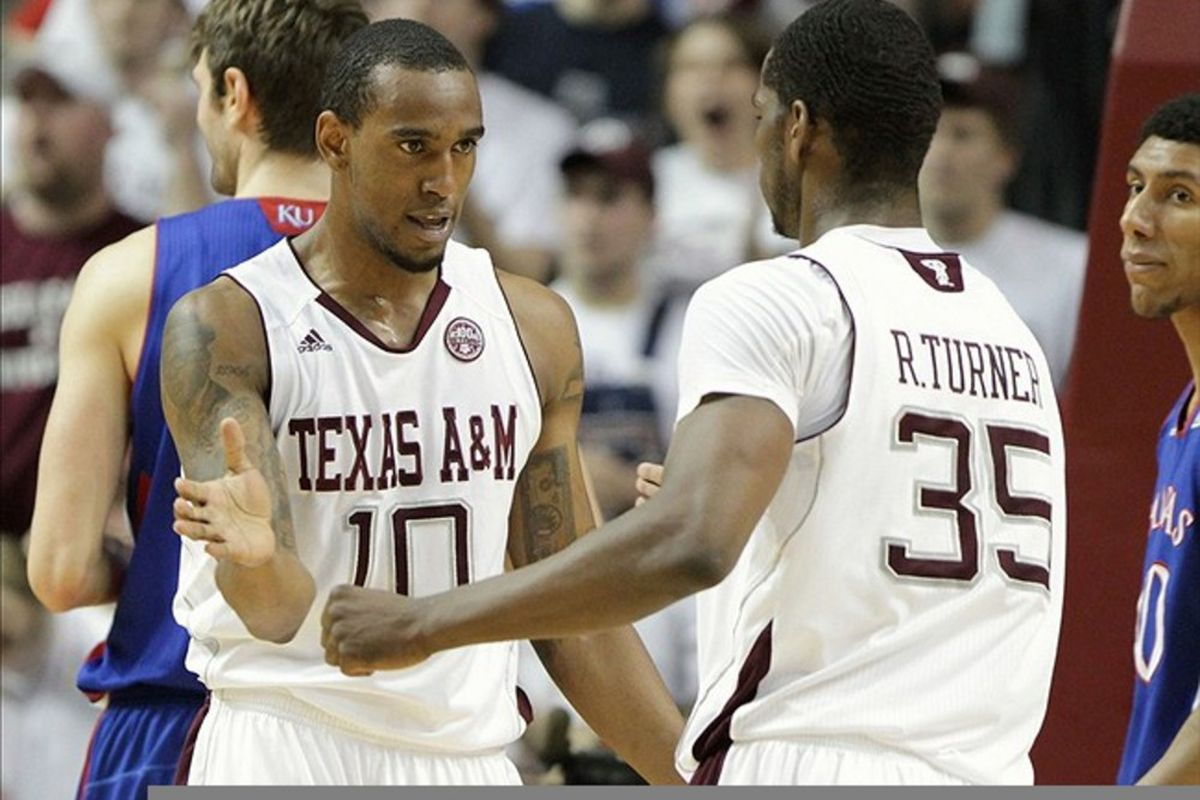 February 22, 2012; College Station, TX, USA; Texas A&M Aggies forward David Loubeau (10) and Ray Turner (35) celebrate a basket in the first half against the Kansas Jayhawks at Reed Arena. Mandatory Credit: Troy Taormina-US PRESSWIRE