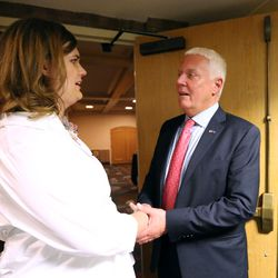 Democratic U.S. Senate candidate Misty Snow talks to Democratic gubernatorial challenger Mike Weinholtz at the Utah Democrats' election night party at the Sheraton in Salt Lake City on Tuesday, Nov. 8, 2016.