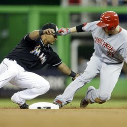 Cincinnati Reds' Todd Frazier, right, is safe at second with a double as he beats the throw to Miami Marlins second baseman Donovan Solano, left, in the second inning during a baseball game, Friday, Sept. 14, 2012, in Miami.
