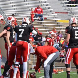 Wisconsin's quarterbacks gather together during a drill.