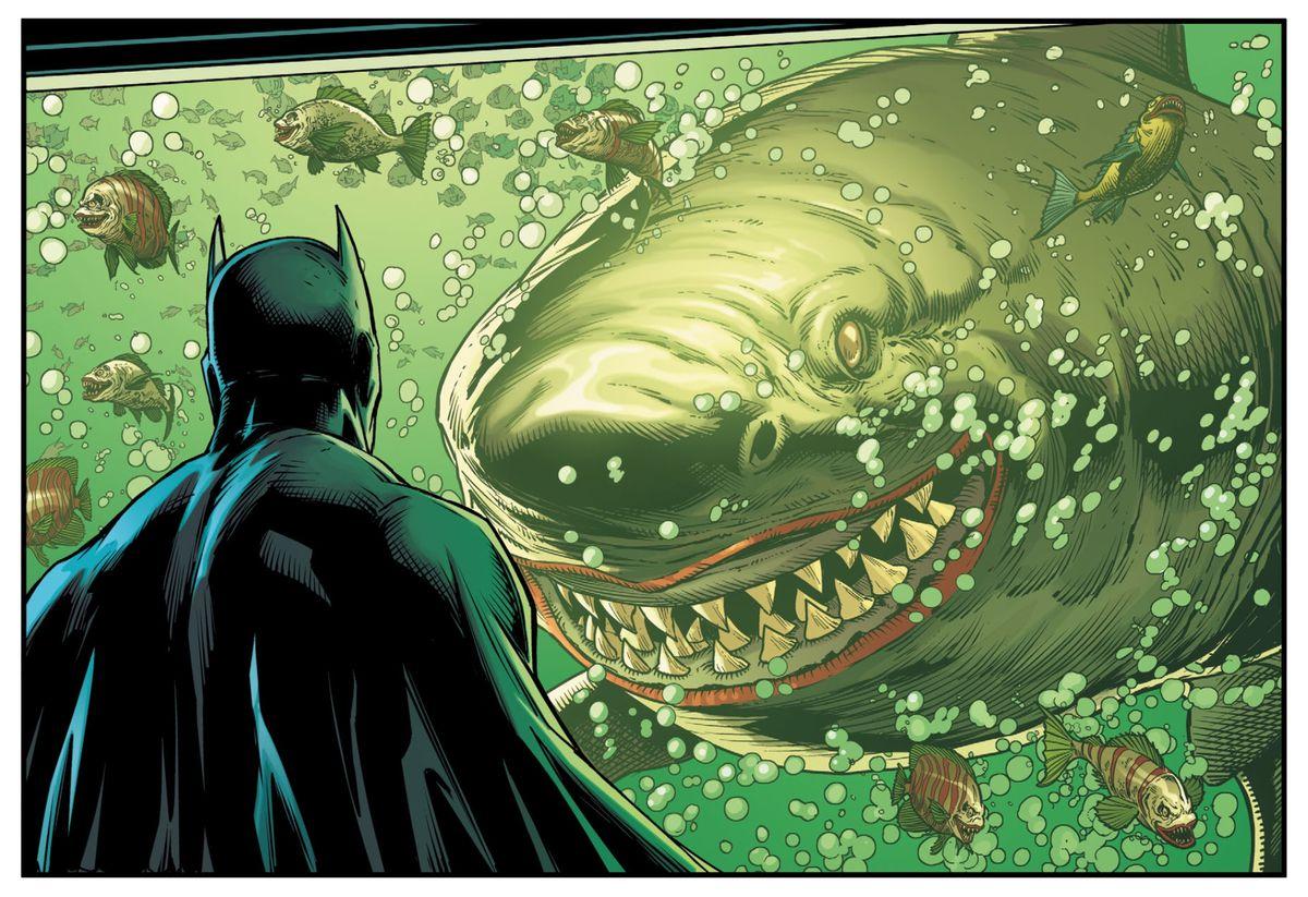Batman stares into a tank of Jokerized fish. A massive Jokerized shark stares back at him, in Three Jokers #1, DC Comics (2020).