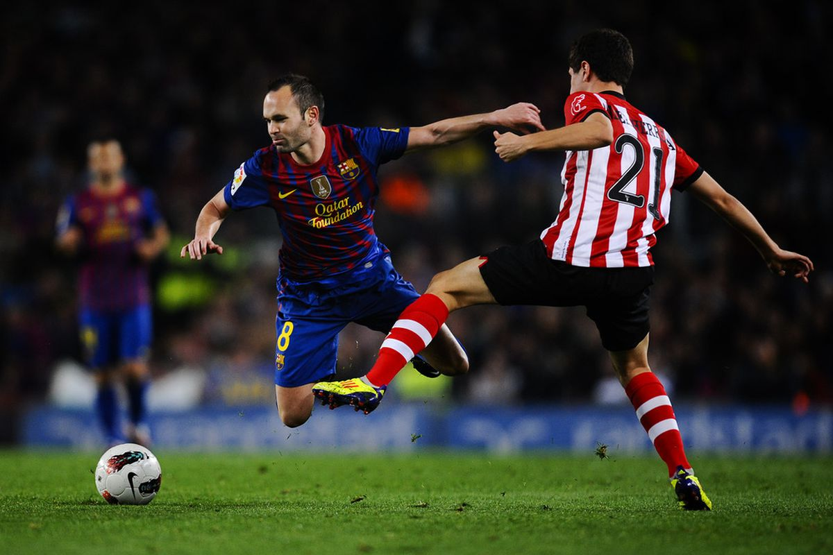 Not even hard tackling could stop Andres Iniesta from scoring yesterday.
