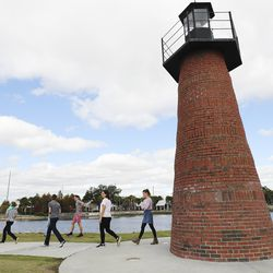 Tom and Heather Wakefield walk with their children — Taylor, Kelsie, Adam, Xande and Lincoln — at Kissimmee Lakefront Park in Kissimmee, Fla., on Monday Dec 21, 2020.
