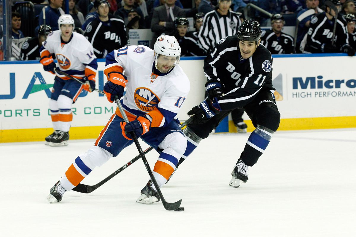 The Lightning's Brian Boyle defends against Lubomir Visnovsky of the New York Islanders in Tampa Bay's 5-2 win Saturday night