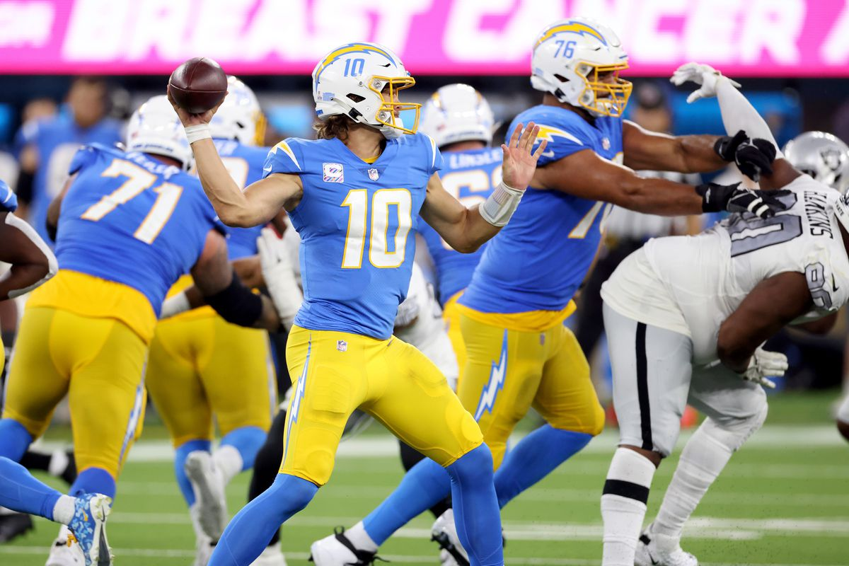 Justin Herbert #10 of the Los Angeles Chargers passes during a 28-14 win over the Las Vegas Raiders at SoFi Stadium on October 04, 2021 in Inglewood, California.