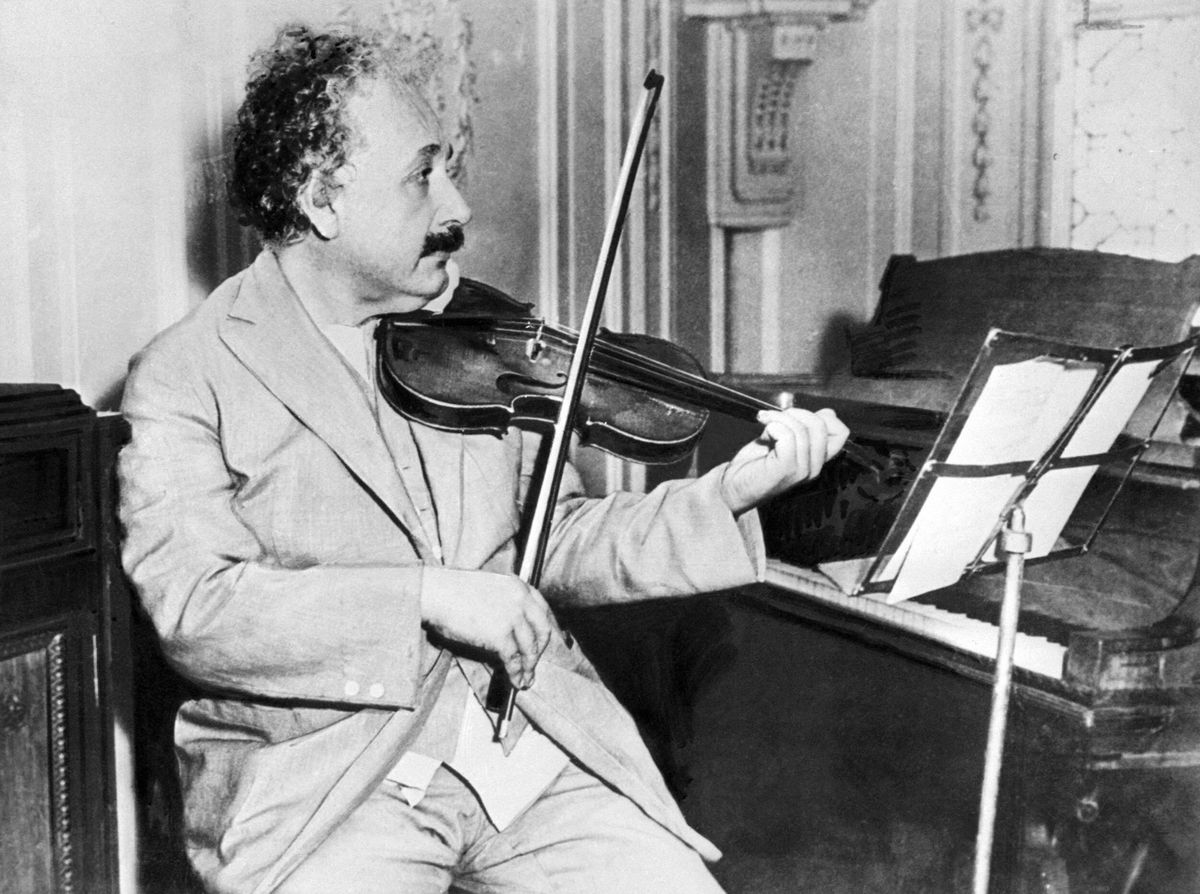 """""""No one's citing your paper? Here's the world's tiniest violin."""" (AFP/Getty Images)"""