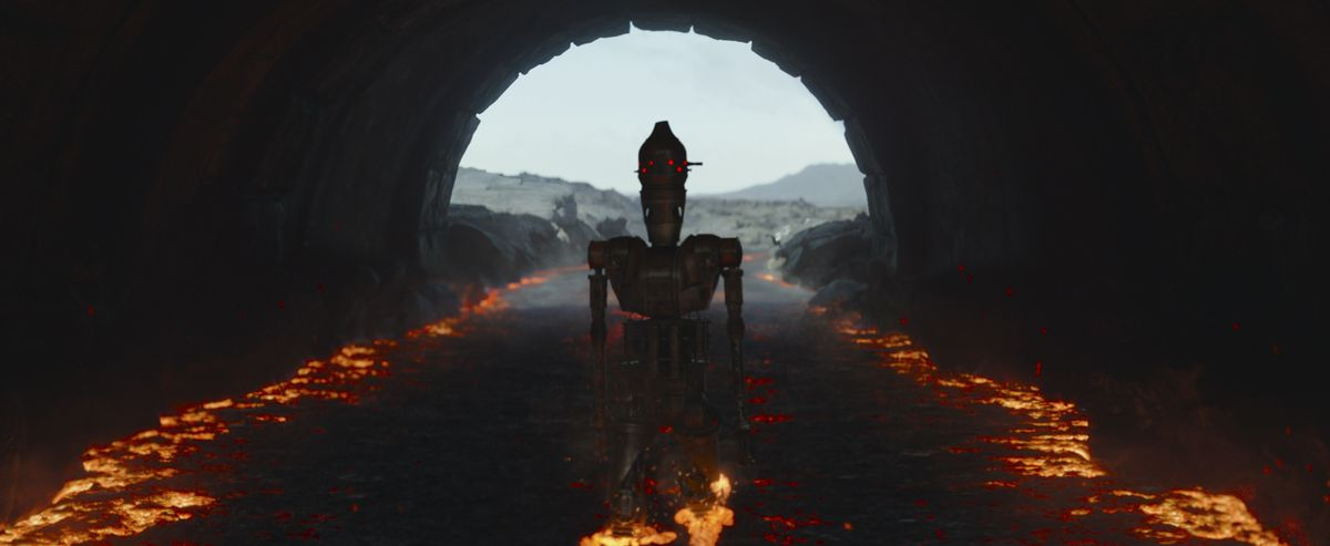 IG-11 marches to his doom through a river of lava in episode 8 of The Mandalorian.