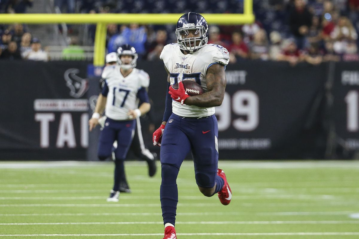 Tennessee Titans running back Derrick Henry runs for a touchdown during the fourth quarter against the Houston Texans at NRG Stadium.