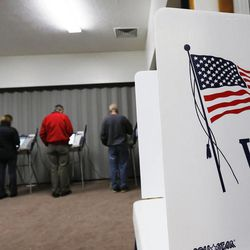 Voters cast their vote at Our Savior's Lutheran Church in Salt Lake County Tuesday, Nov. 4, 2014.