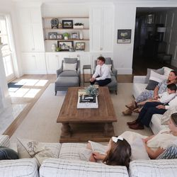 Thomas and Mandi Godfrey and their family watch President Russell M. Nelson during The Church of Jesus Christ of Latter-day Saints' 191st Annual General Conference from their home in Holladay on Saturday, April 3, 2021.