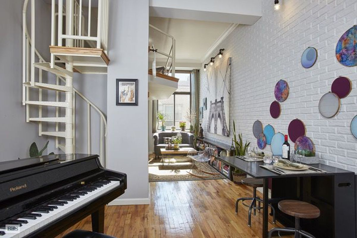 Entryway of Gramercy loft with spiral staircase
