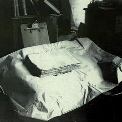 The printer's manuscript of the Book of Mormon rests on a table in this early 20th-century photograph. The LDS Church purchased the manuscript from the Community of Christ on Wednesday, Sept. 20, 2017.
