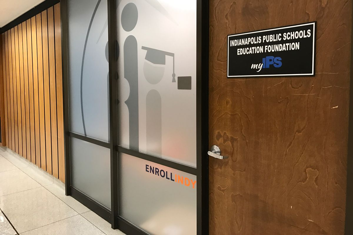 The door to the Enroll Indy office in Indianapolis Public Schools headquarters.
