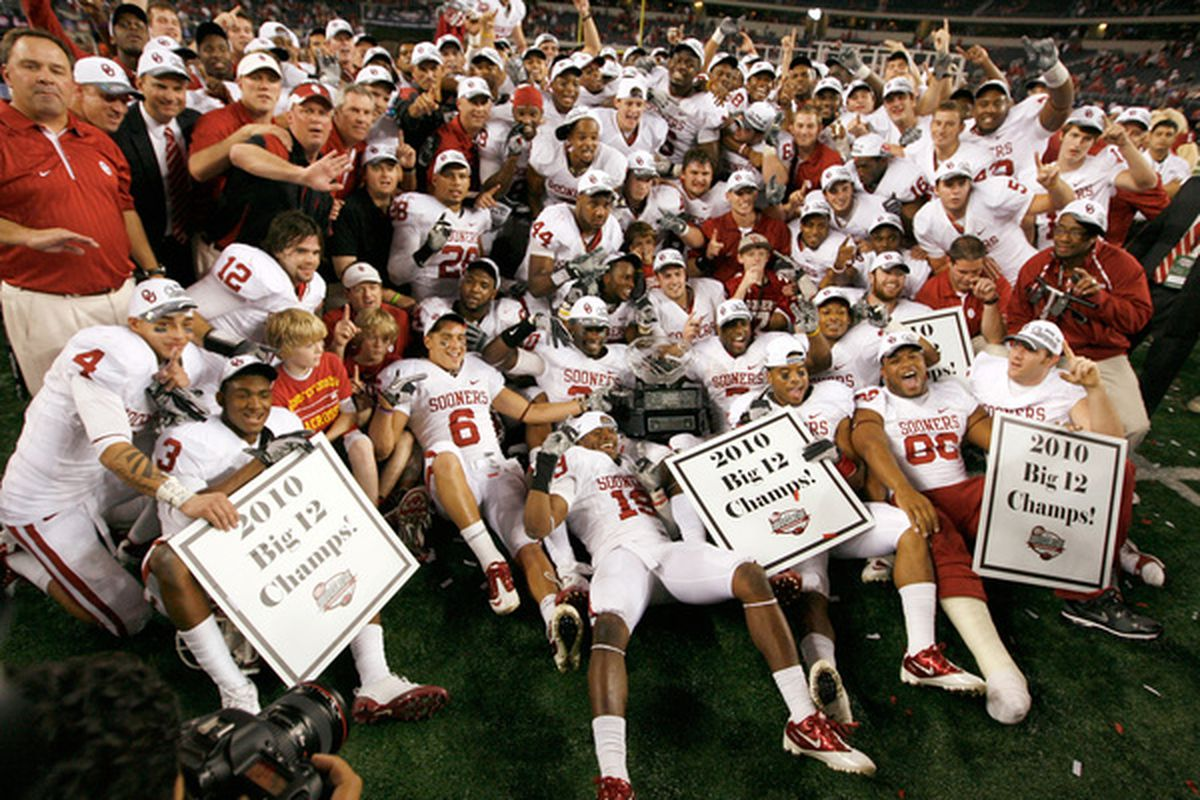 ARLINGTON TX - DECEMBER 04:  The Oklahoma Sooners celebrates with the Big 12 Championship Trophy after the Sooners beat the Nebraska Cornhuskers 23-20 at Cowboys Stadium on December 4 2010 in Arlington Texas.  (Photo by Tom Pennington/Getty Images)
