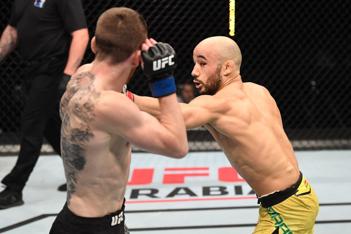 Marlon Moraes of Brazil punches Cory Sandhagen in their bantamweight bout during the UFC Fight Night event inside Flash Forum on UFC Fight Island on October 11, 2020 in Abu Dhabi, United Arab Emirates.