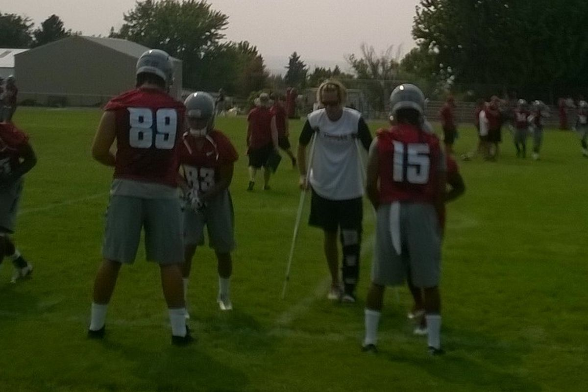 David Yost instructs inside receivers on how to use their hands Sunday. The group worked on the same drill Monday.