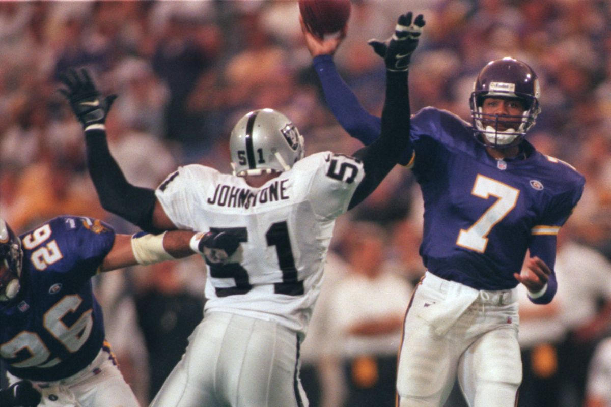 Minneapolis, MN 9/19/99 - metrodome - Vikings vs Oakland — Viking quarterback Randall Cunningham throws a pass over the outstretched arms of Oakland√ïs Lance Johnstone while runningback Robert Smith, left, attempts to push him away during the fourth q
