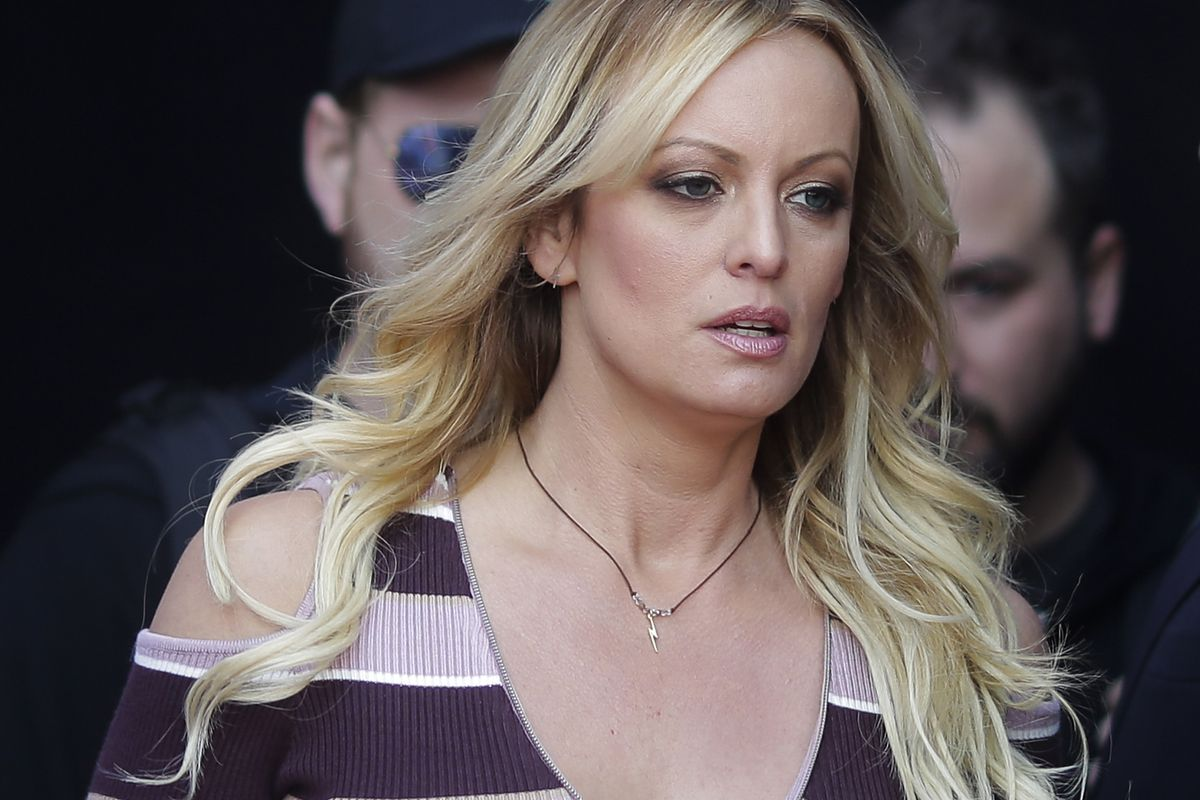"""FILE - In this Thursday, Oct. 11, 2018, file photo, adult film actress Stormy Daniels arrives for the opening of the adult entertainment fair """"Venus,"""" in Berlin. On Monday, Oct. 15, 2018, a federal judge dismissed Daniels' defamation lawsuit against Presi"""