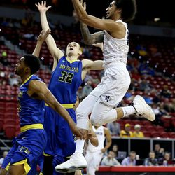 Utah State Aggies Jalen Moore shoots against San Jose State Spartans' 20 Isaac Thornton and 32 Ryan Welage at the Mountain West Men's Basketball Championships at the Thomas & Mack Center, Las Vegas, Nevada on Wednesday, March 8, 2017.