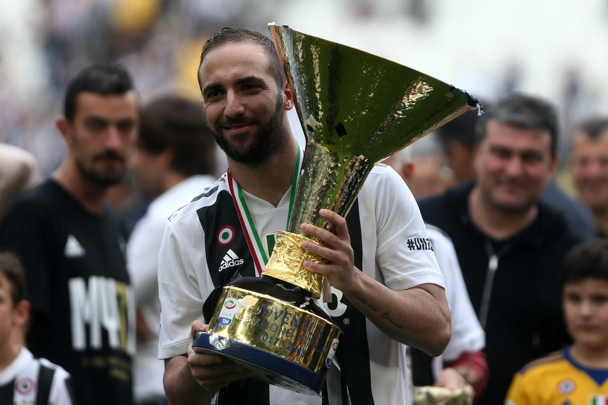 Gonzalo Higuain of Juventus FC celebrating with the trophy...