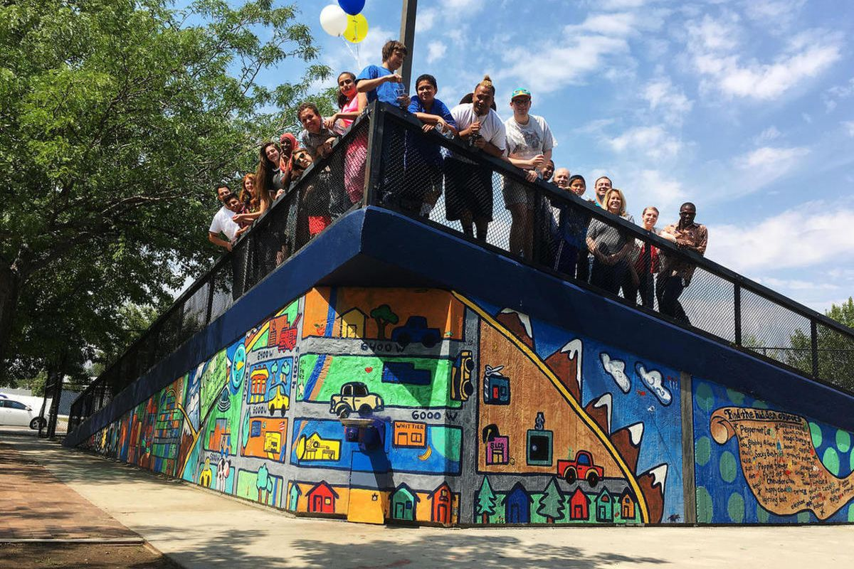"""FILE """""""" West Valley community members stand for a group photo on a new mural in West View Park in West Valley City on Thursday, Aug. 4, 2016. Recent U.S. Census data show that West Valley City has a 52 percent minority population, jumping from 9 percent i"""